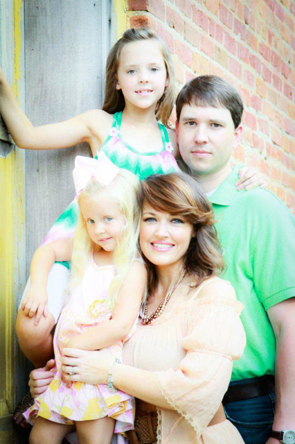 Melanie with her husband and daughters.