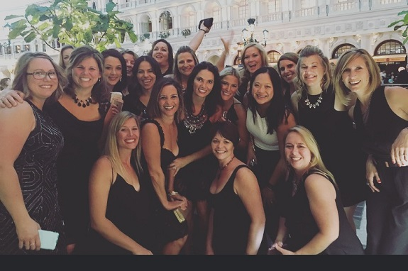 Some of Carly's partners, Team ASPIRE, celebrating their life changing businesses and friendships at convention in Vegas. Carly describes her team as inspiring, supportive, and empowering.