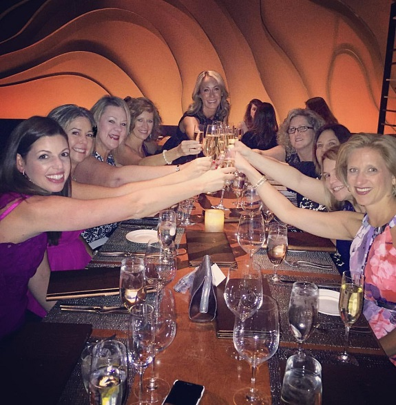 Gina and her team toasting their success at the Las Vegas Convention