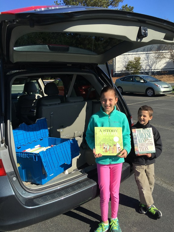 Giving back is often a family affair...Heather's children helping her drop off books to Read and Feed.