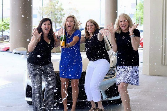R+F Consultant Kellye Ryan celebrating Lexus